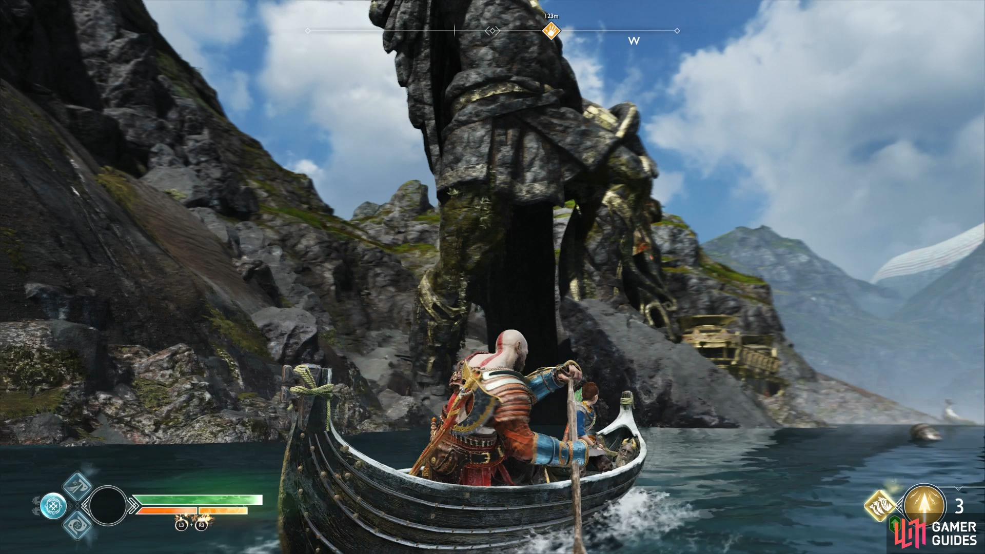 Take the boat through the legs of the Thor statue to reach the cavern.