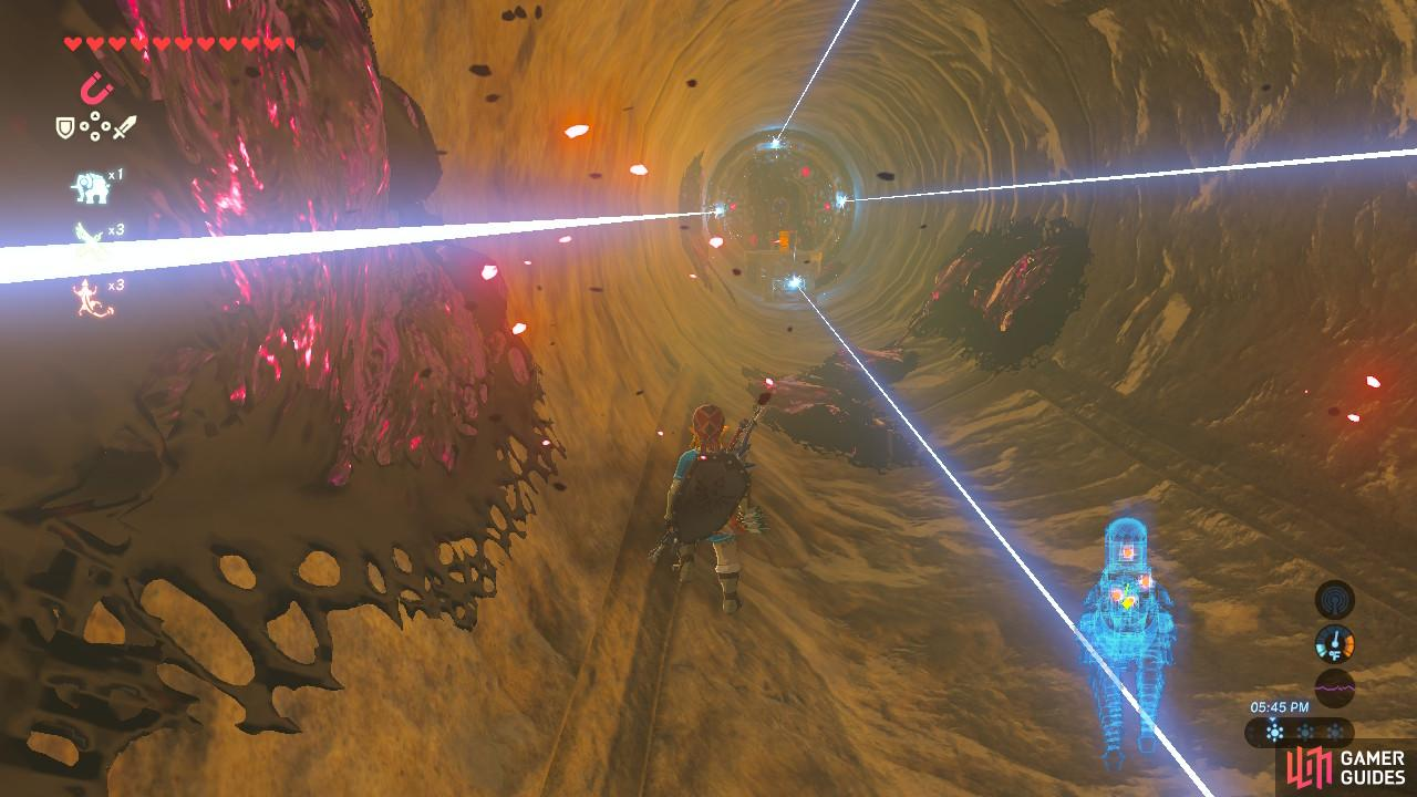 Run between the lasers as fast as you can so you don't get stuck and hit