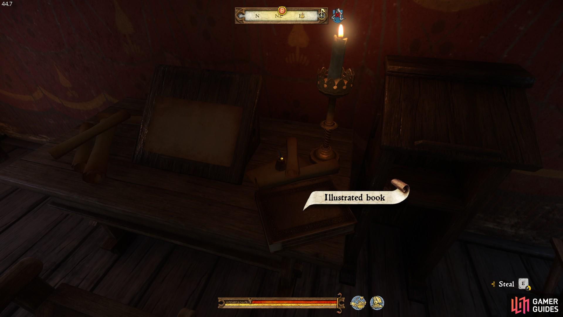 The book is located on the table directly in front of the doorway.