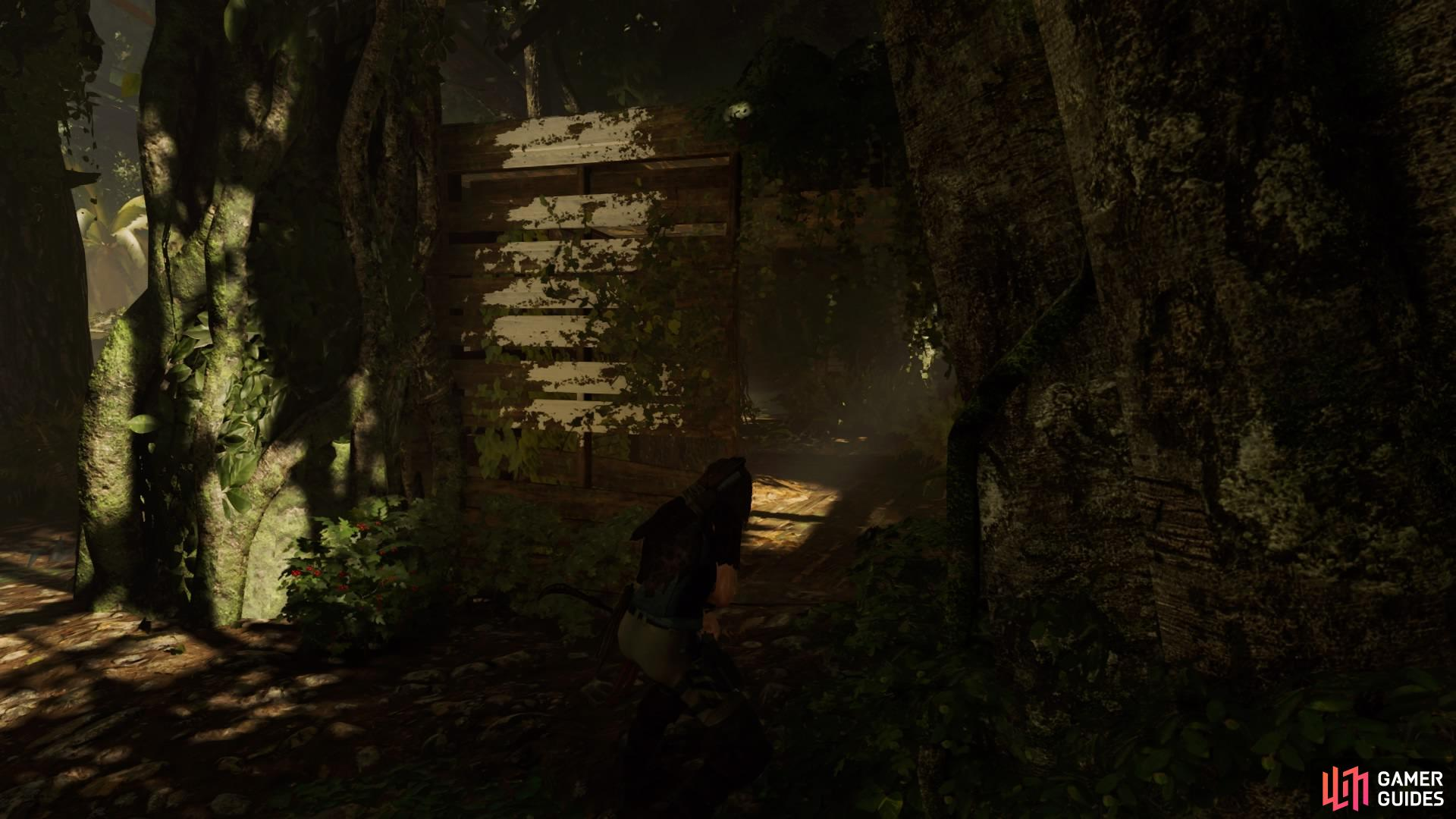 Run through the wooden structure to take out the second enemy