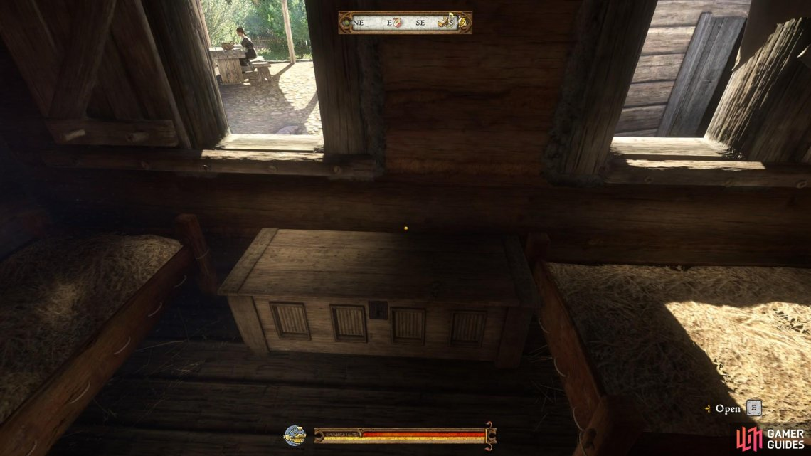 The first home chest available to use is located next to Henry's bed in Rattay Mill.