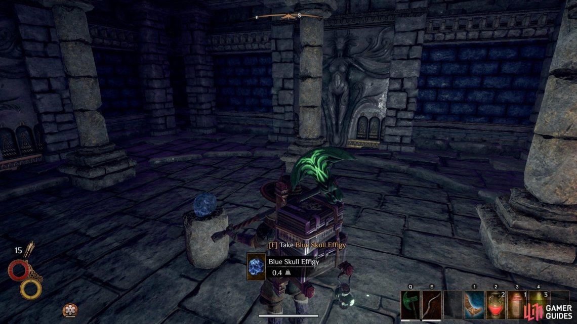 Take the Blue Skull Effigy from the pedestal and be ready to fight a ghost that will spawn immediately after.