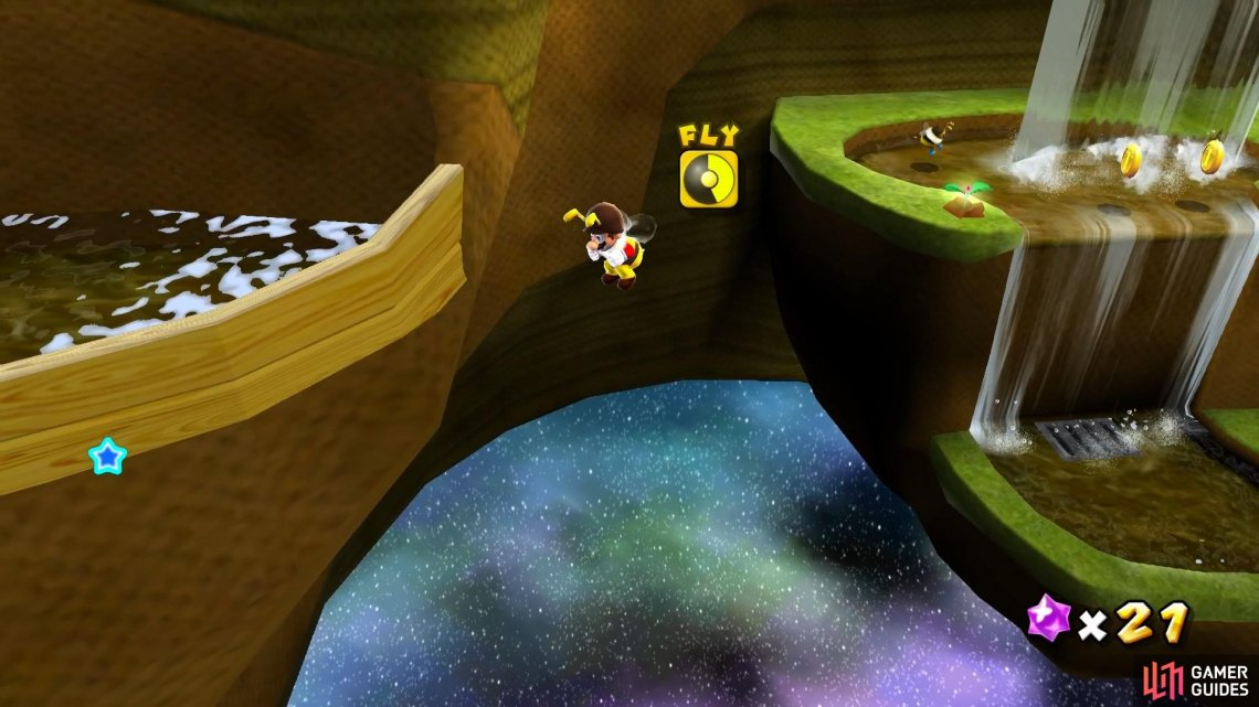 You'll need to fly across to the otherside of the planet using Bee Mario form.