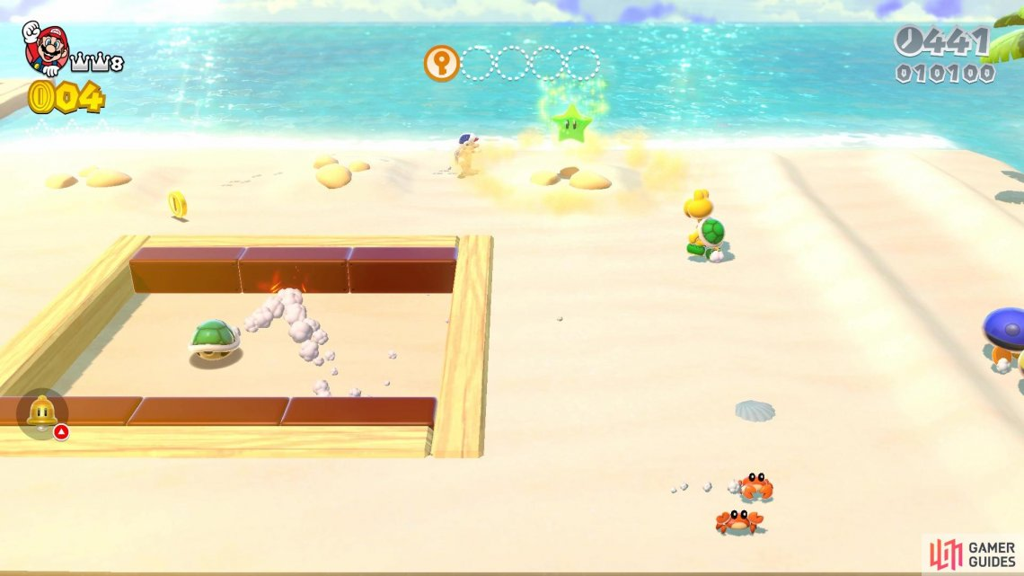 The first Green Star appears when you destroy the Goomba sand sculpture