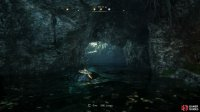 Dive under the water and swim through the hole beneath it to reach the hidden chamber.