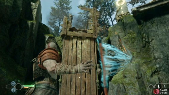 destroy the barricade to boost Atreus up and reach the Lore Marker.