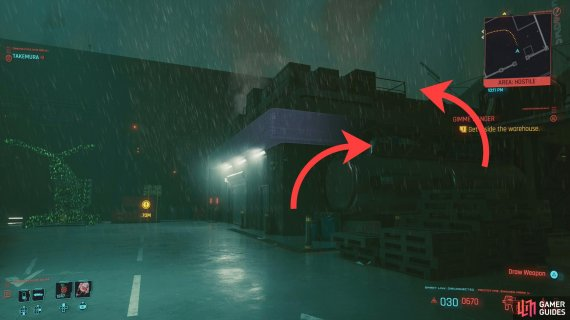 You can jump onto a fuel tank, then onto the roof of a building adjacent to the warehouse,
