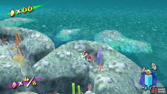 The red coins are hidden in between seaweeds and anemones within the coral reef