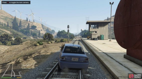 Park the car on the tracks and wait for the train to approach